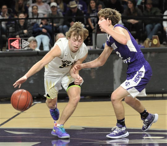 Jayton's Tye Scogin, left, tries to get around Irion County's Kaden Councilman. Jayton beat the Hornets 47-32 in the Region II-1A championship game Saturday, March 2, 2019, at Abilene Christian's Moody Coliseum.