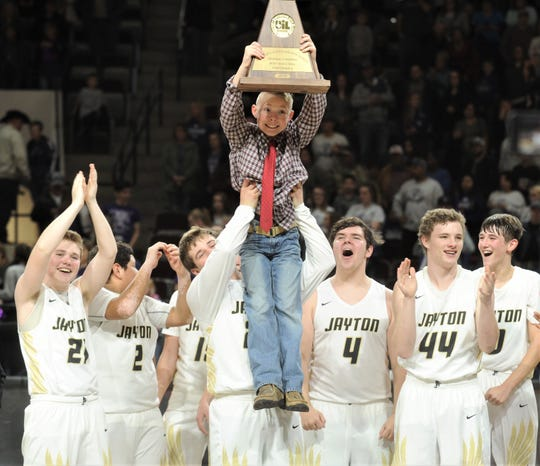 Easton Bleiker, the son of Jayton coach Ryan Bleiker, holds up the Region II-1A championship trophy after the Jaybirds beat Irion County 47-32 in the region final Saturday, March 2, 2019, at Abilene Christian's Moody Coliseum.