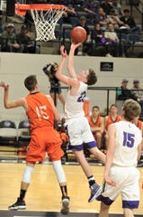 Irion County's Mo Morrow (23) sails to the basket as Paducah's Tate Huchinson (15) defends. Irion County won the Region II-1A semifinal game 69-58 on Friday, March 1, 2019, at Abilene Christian's Moody Coliseum.