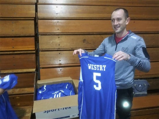 Andrew Chapin delivered new jerseys and warmups to the members of the Cereal City Hoopsters fifth grade basketball team that he briefly coached when their head coach didn't show up for a tournament.