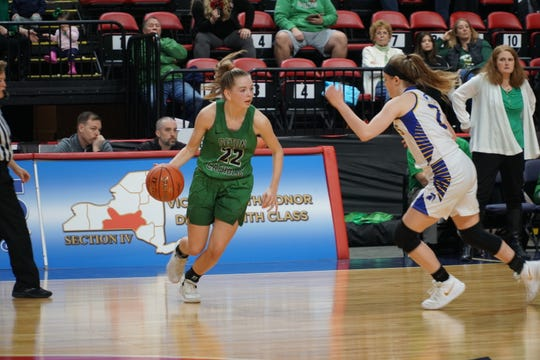 Seton Catholic Central sophomore Reese Vaughan dribbles toward the hoop on Saturday in the Section 4 Class A title game.