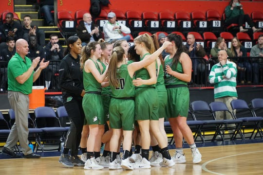 Seton Catholic Central celebrates its 65-50 victory over Maine-Endwell on Saturday in the Section 4 Class A final at Floyd L. Maines Veterans Memorial Arena.