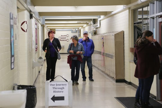 "Visitors walk the halls of Central Kitsap Middle School one last time at ""Central Kitsap Middle School Through the Decades"" on Feb. 26, 2019. The school, built in 1959, will be demolished this spring. Students will move to a new middle school building after spring break."