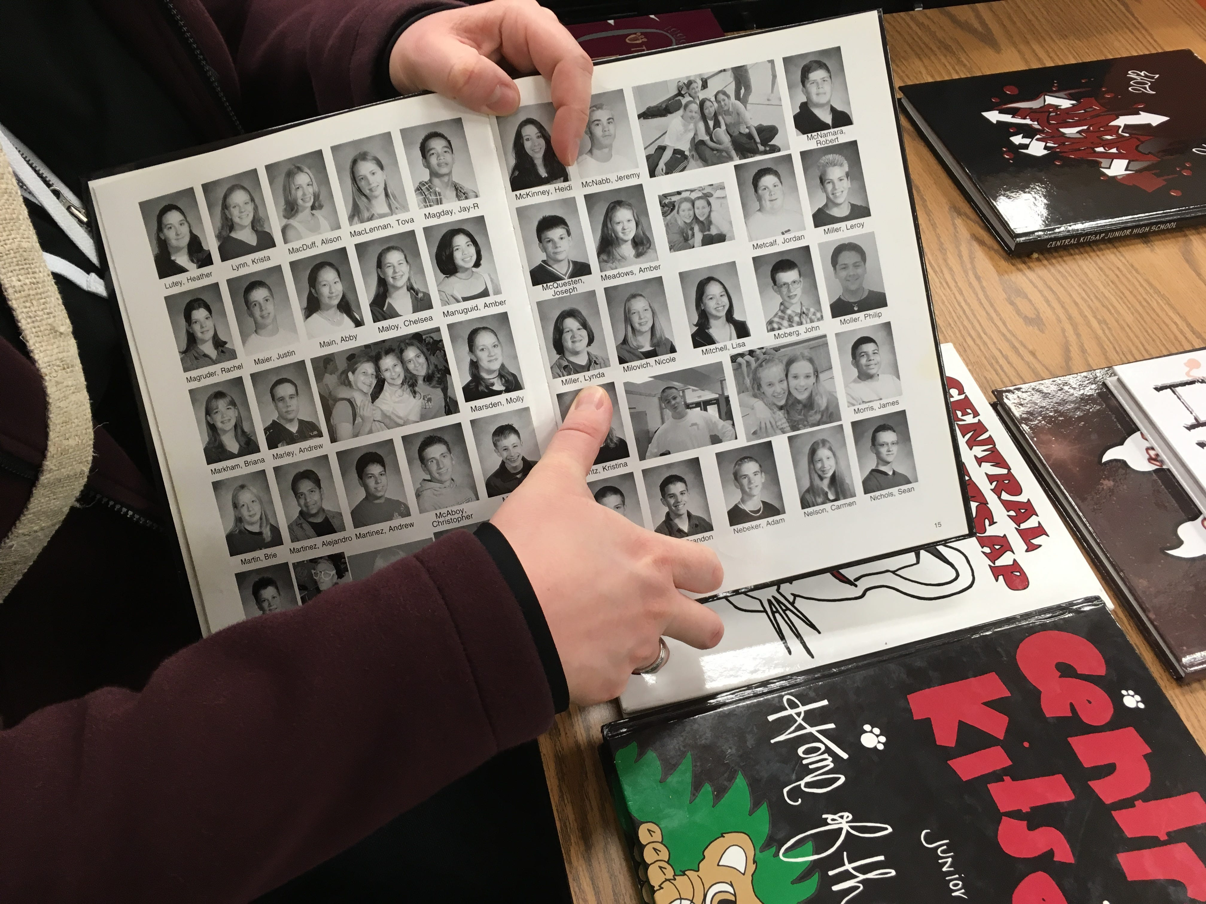 "Lynda Murray, a Central Kitsap Middle School graduate, shows her yearbook photo to her niece at ""Central Kitsap Middle School Through the Decades"" on Feb. 26, 2019. The school, built in 1959, will be demolished this spring. Students will move to a new middle school building after spring break."