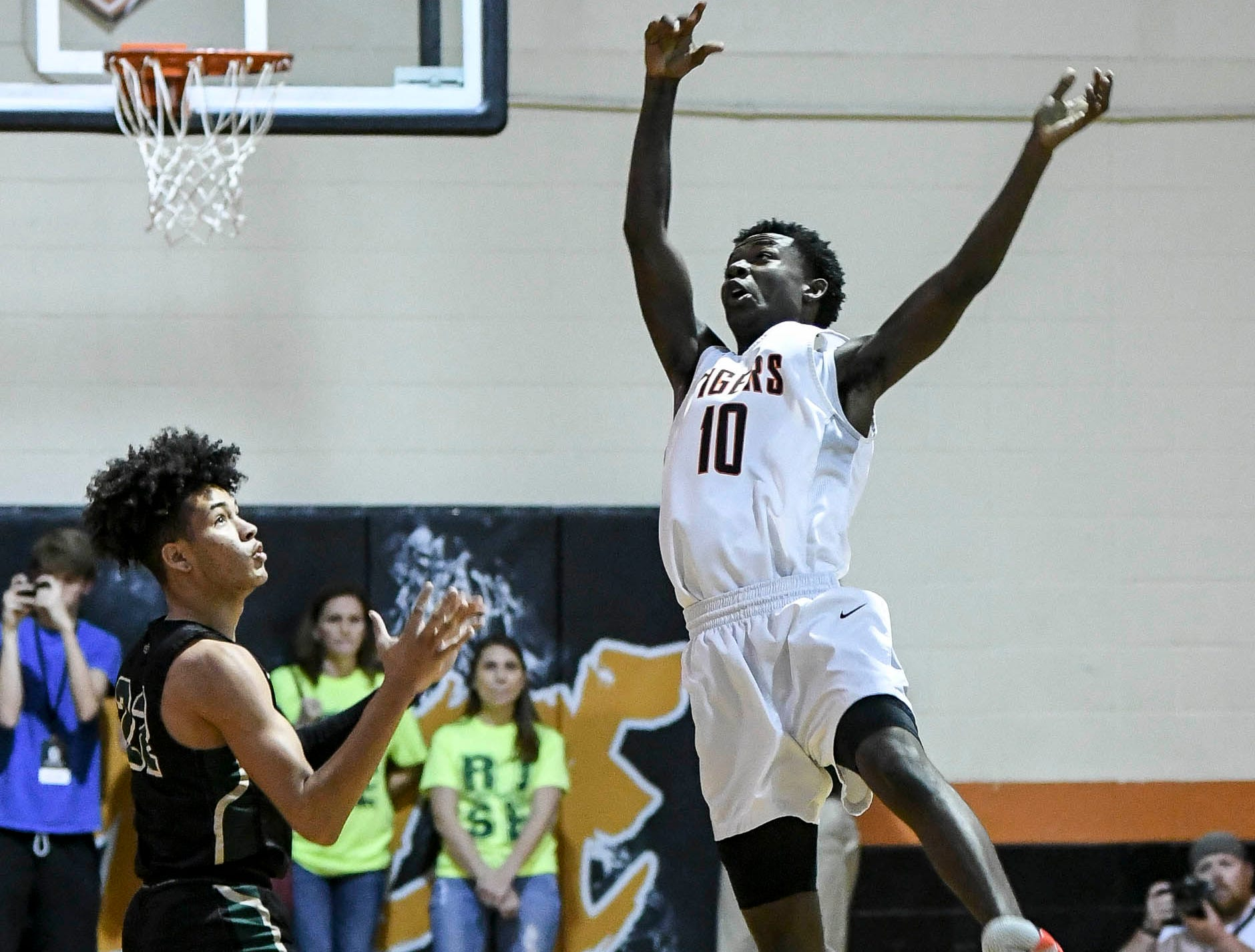 Cocoa's Samarion Bryant knocks the ball away from Brandon Farmer of The Villages during Regional Final in Cocoa ee