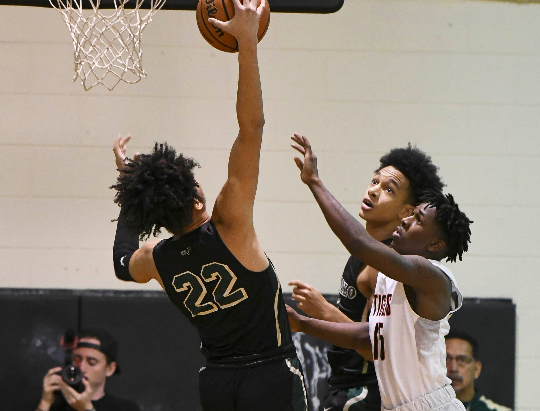 Brandon Farmer of The Villages (22) grabs a rebound during Friday's basketball Regional Final in Cocoa