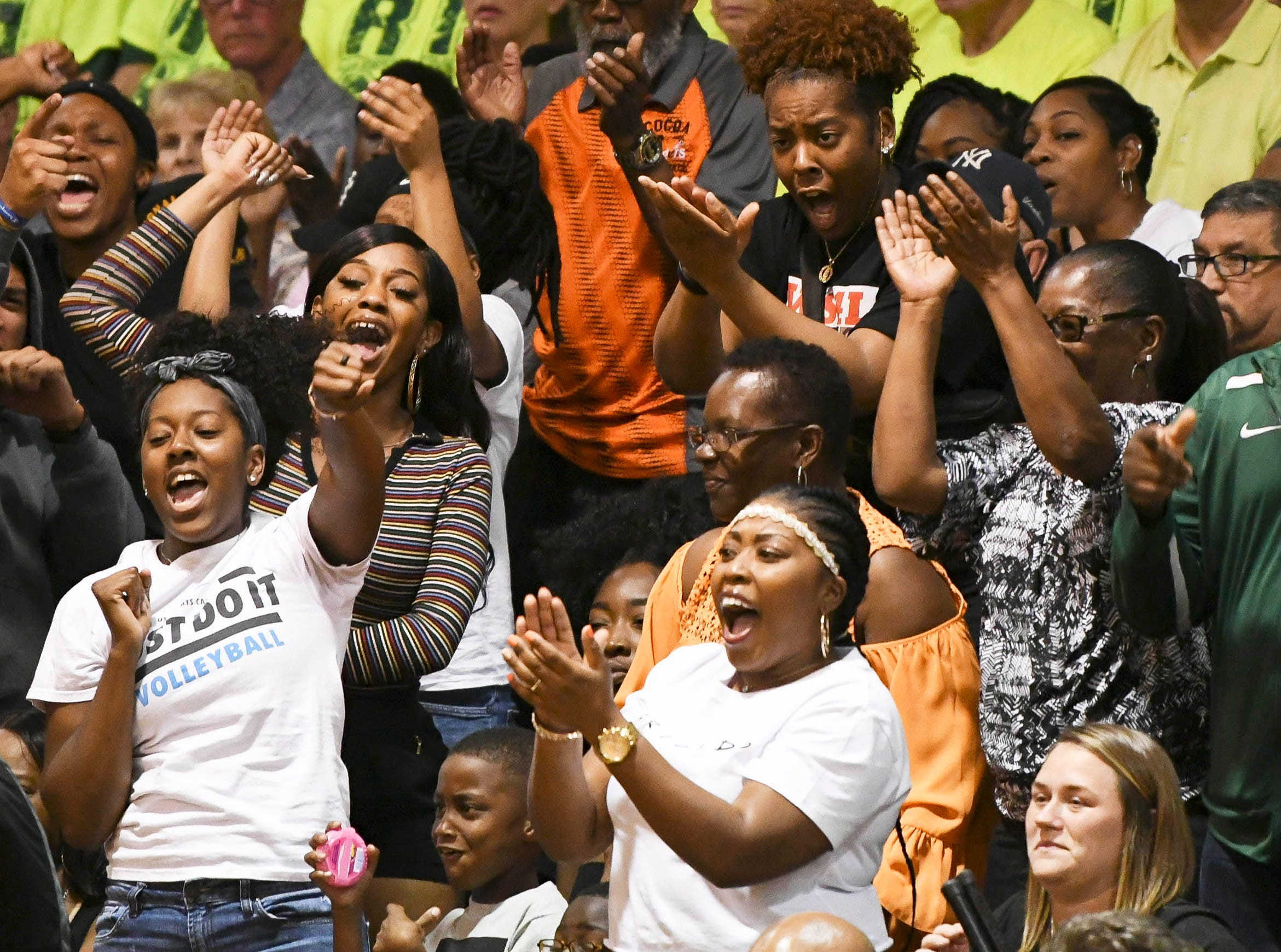 Cocoa Tiger fans cheer for their team during Friday's basketball Regional Final in Cocoa