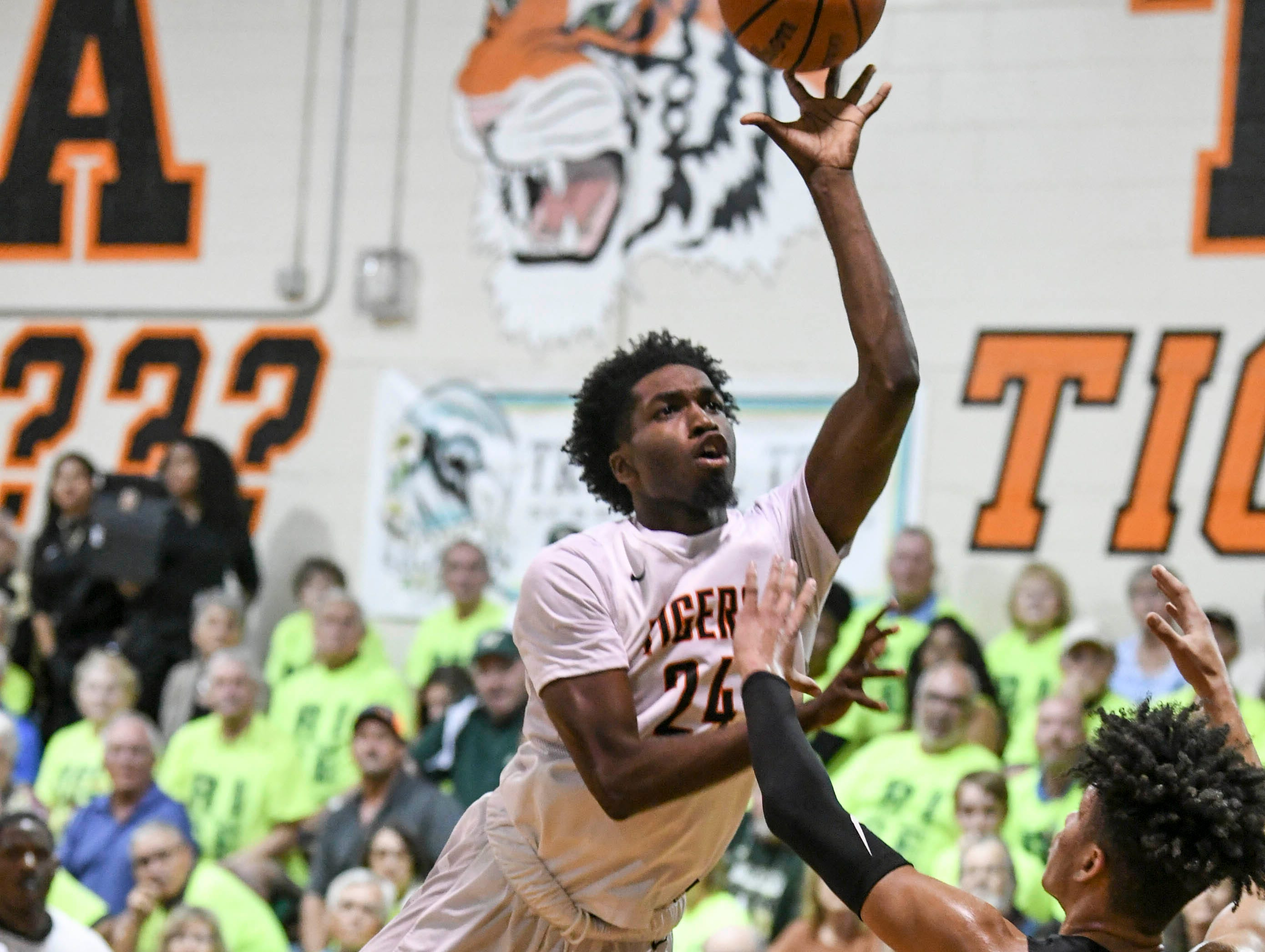Marquise Freeman of Cocoa drives to the basket during Friday's basketball Regional Final in Cocoa