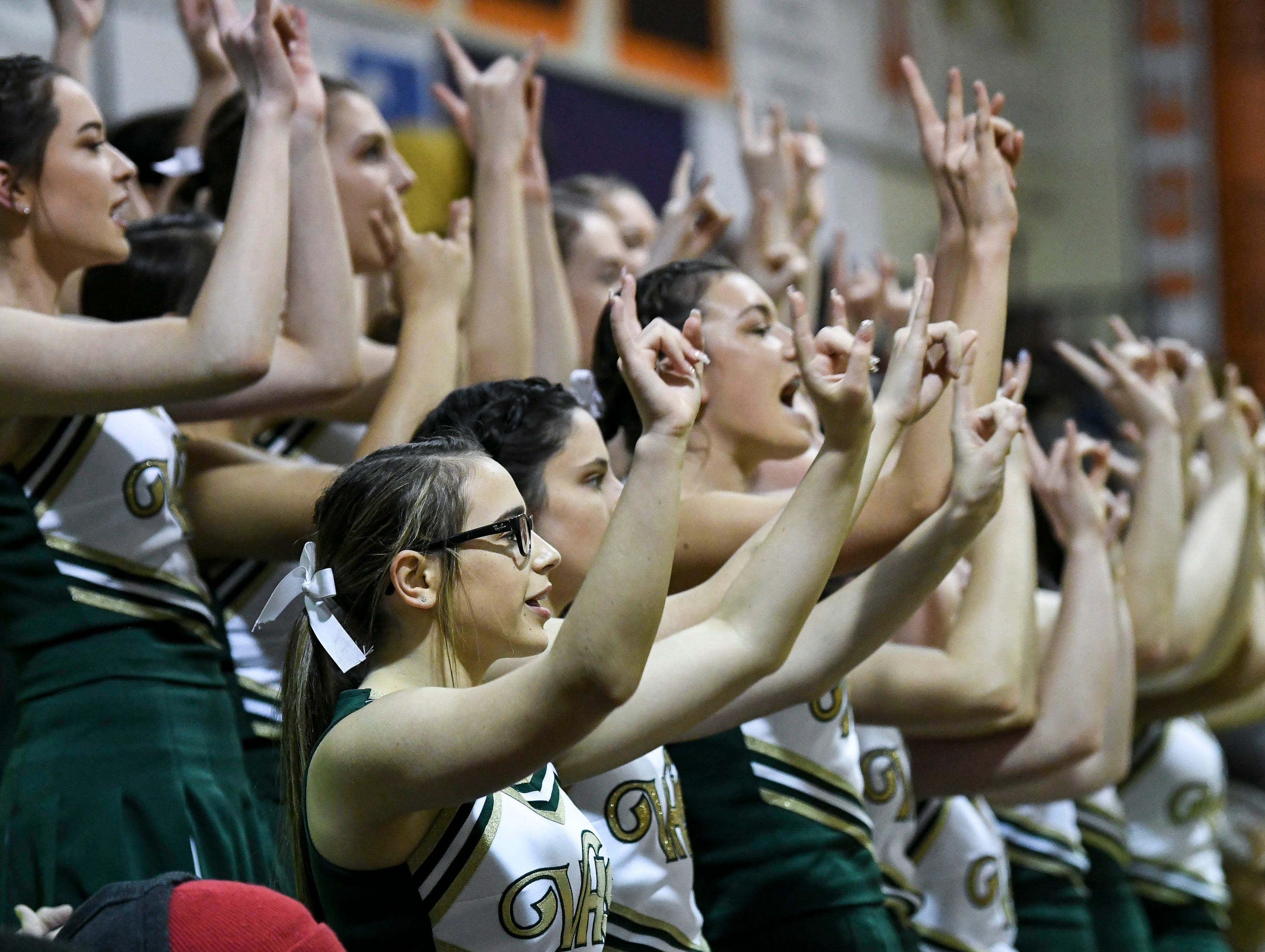 Cheerleaders from The Villages support their team during Friday's basketball Regional Final in Cocoa