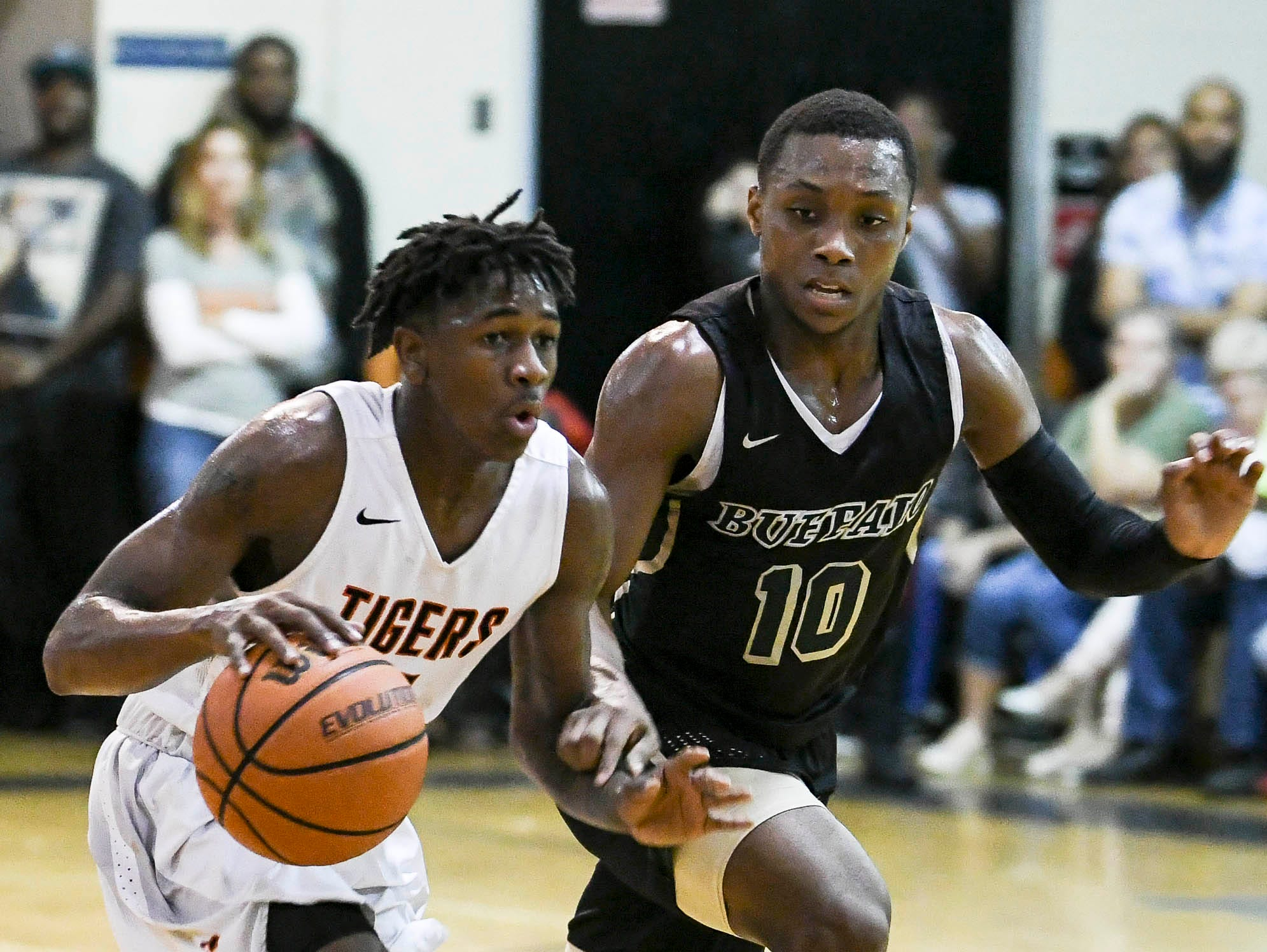 Cocoa's Latrell Pace drives past Terry Every of The Villages during Friday's basketball Regional Final in Cocoa