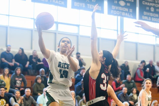 Rice's Haley Walker (10) leaps for a lay up over Rutland's Leigh Charron (33) during the girls basketball quarterfinal game between the Rutland Raiders and the Rice Green Knights at Rice Memorial High School on Saturday afternoon March 2, 2019 in South Burlington, Vermont.