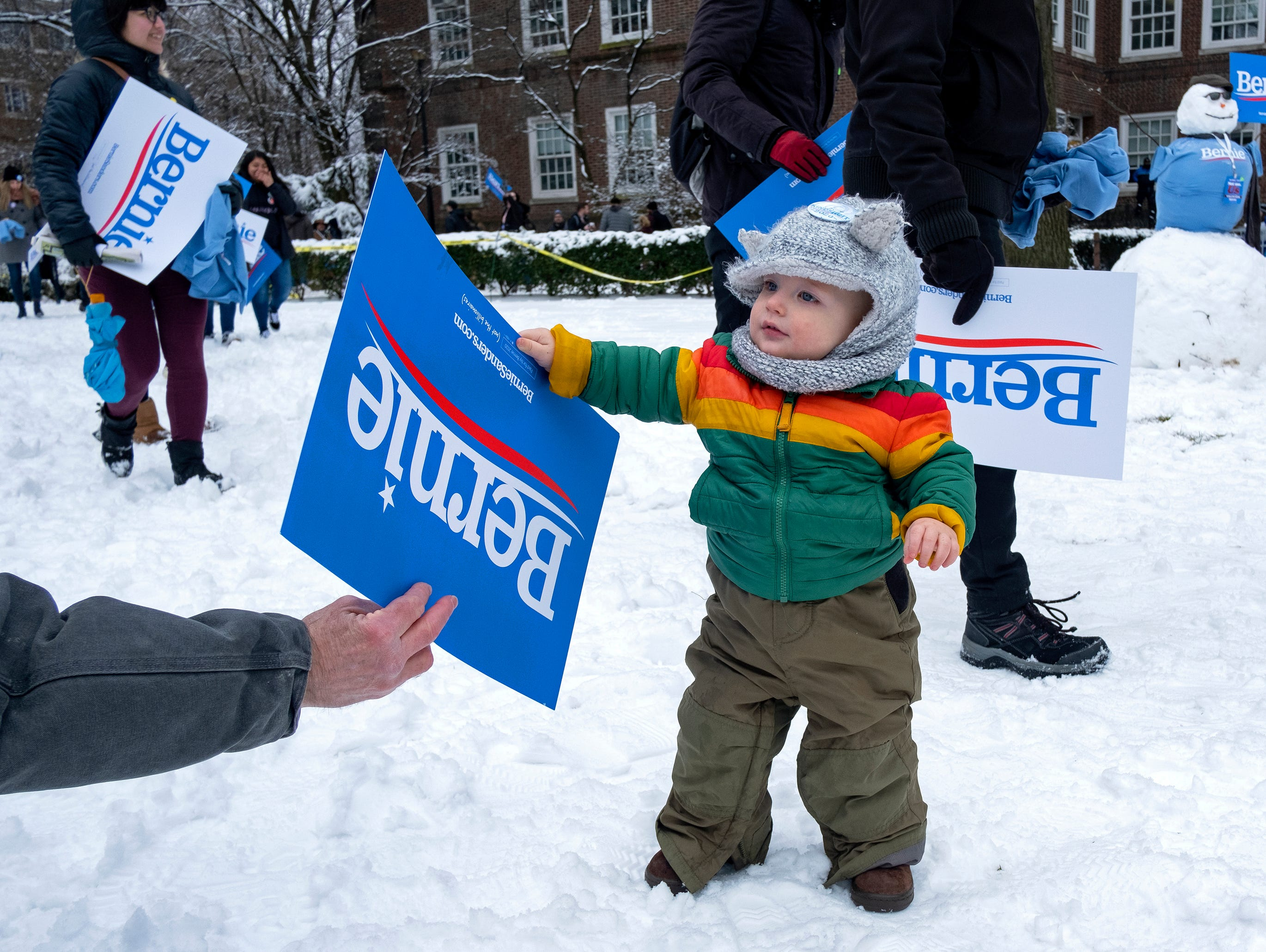 Cal Bonavita, 15 months, of New York, is handed a campaign before a rally for Sen. Bernie Sanders, I-Vt., as Sanders kicks off his political campaign Saturday, March 2, 2019, in the Brooklyn borough of New York as he makes a bid for President of the United States in 2020, his second campaign for the office. (AP Photo/Craig Ruttle)