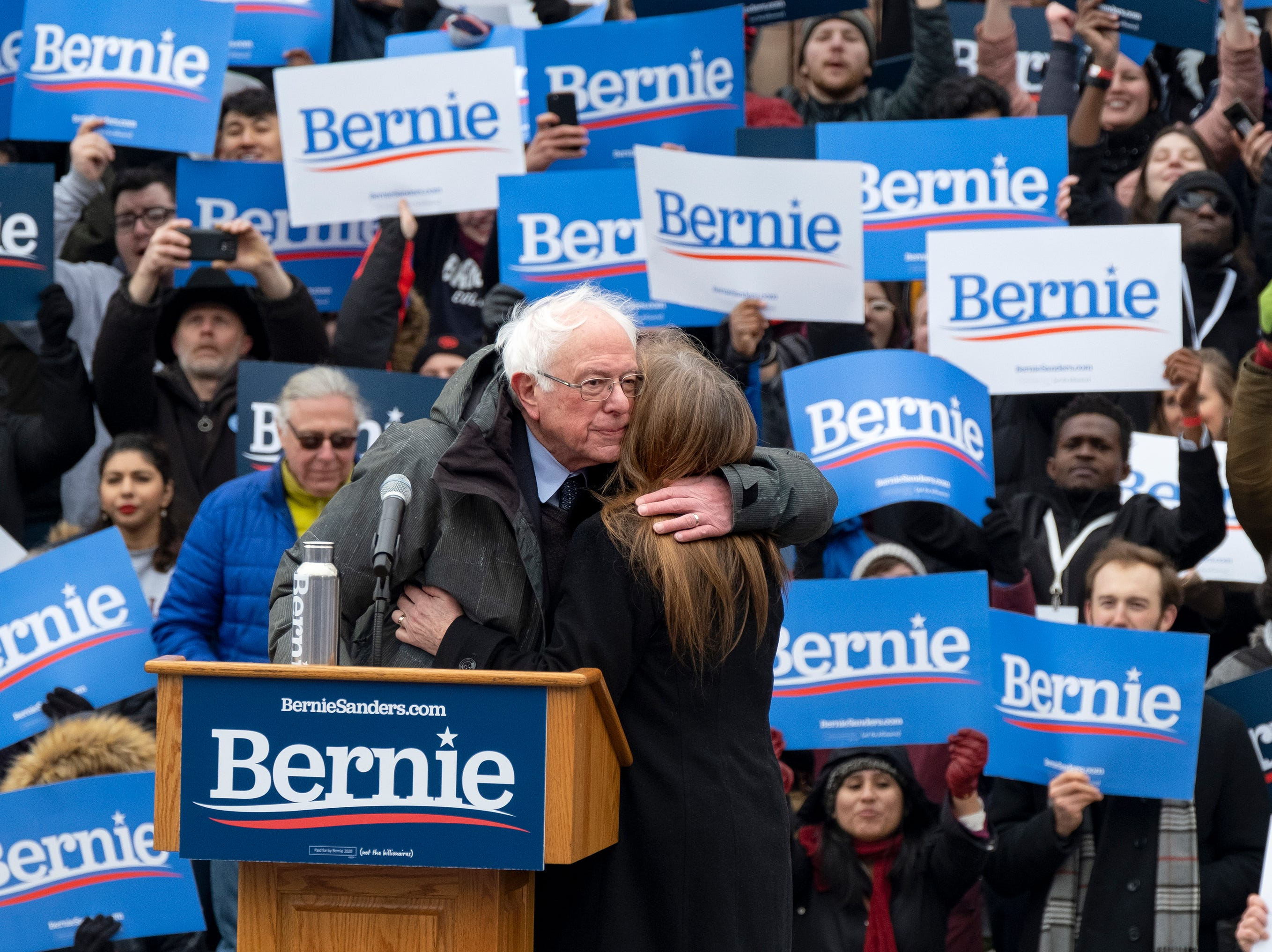 Sen. Bernie Sanders, I-Vt., hugs his wife Jane after he finished speaking  Saturday, March 2, 2019, in the Brooklyn borough of New York.  Sanders returned to Brooklyn, his birthplace, for the first rally of his second presidential campaign and sought to tie his working-class background to his populist views that are helping reshape the Democratic Party.