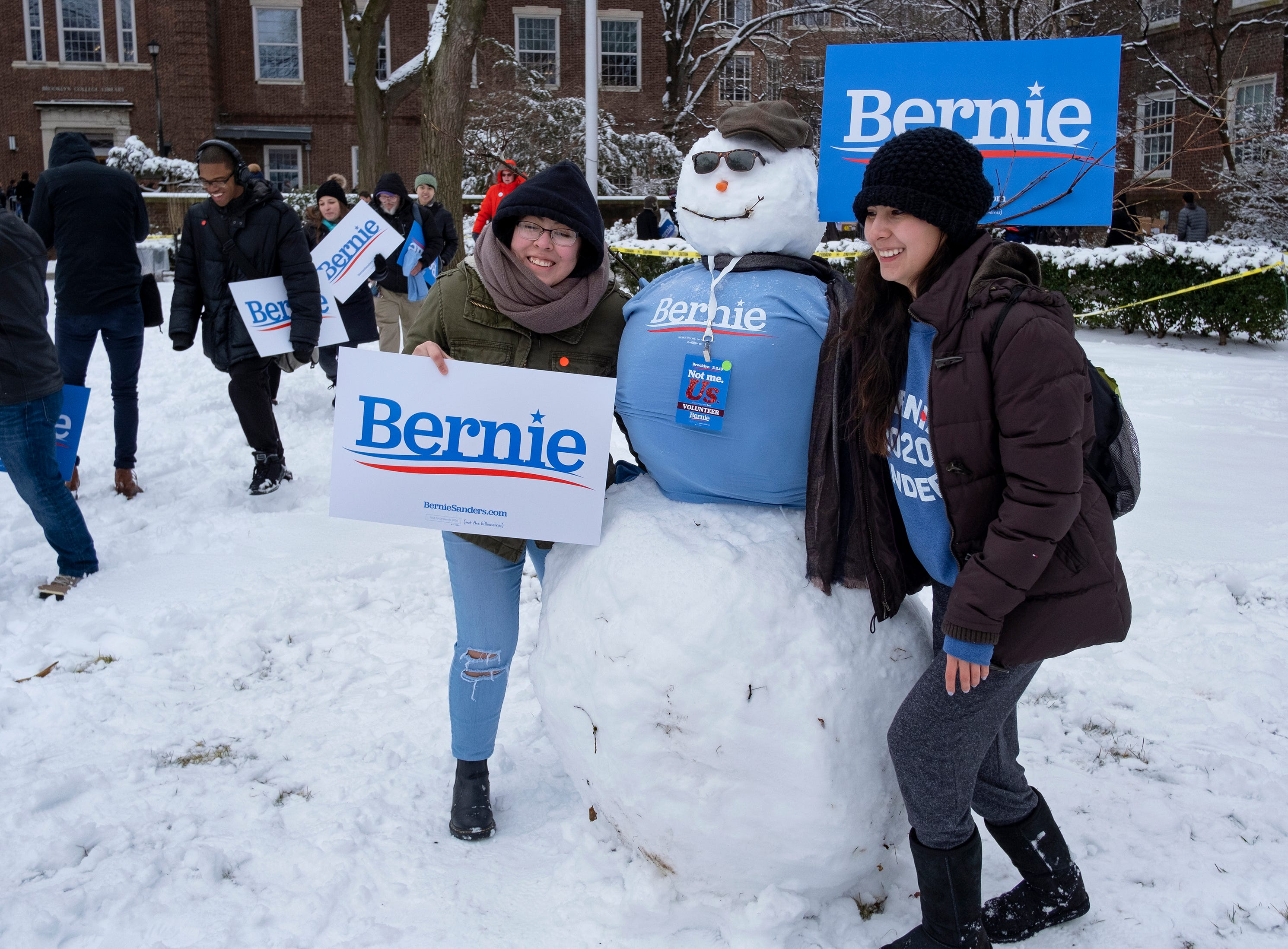 People pose with a snowman at a rally for Sen. Bernie Sanders, I-Vt., as he kicks off his political campaign Saturday, March 2, 2019, in the Brooklyn borough of New York as he makes a bid for President of the United States in 2020, his second campaign for the office. (AP Photo/Craig Ruttle)
