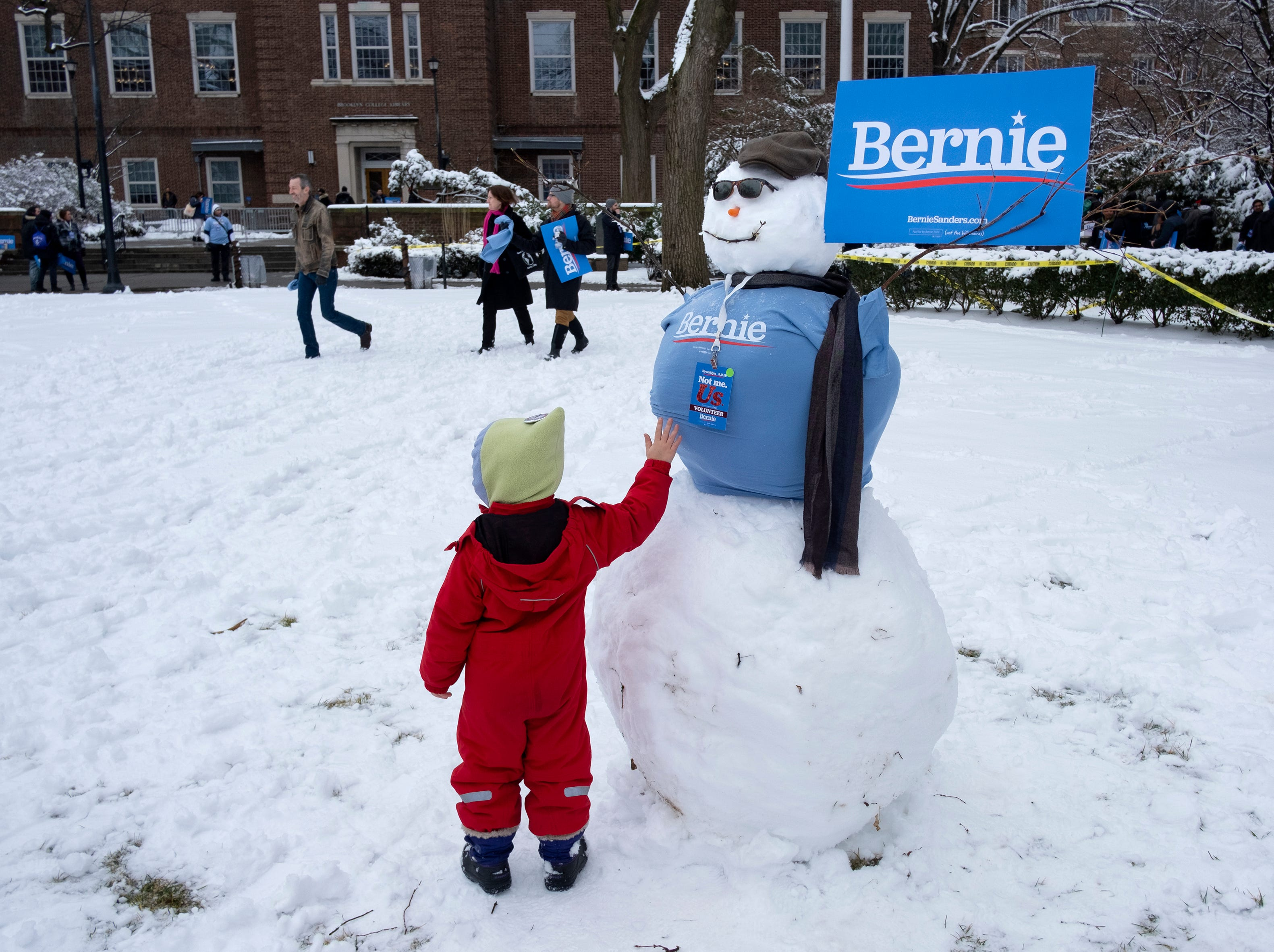 Katherine Bonavita, 4, of New York, reaches out to a snowman before a rally for Sen. Bernie Sanders, I-Vt., as Sanders kicks off his political campaign Saturday, March 2, 2019, in the Brooklyn borough of New York as he makes a bid for President of the United States in 2020, his second campaign for the office.