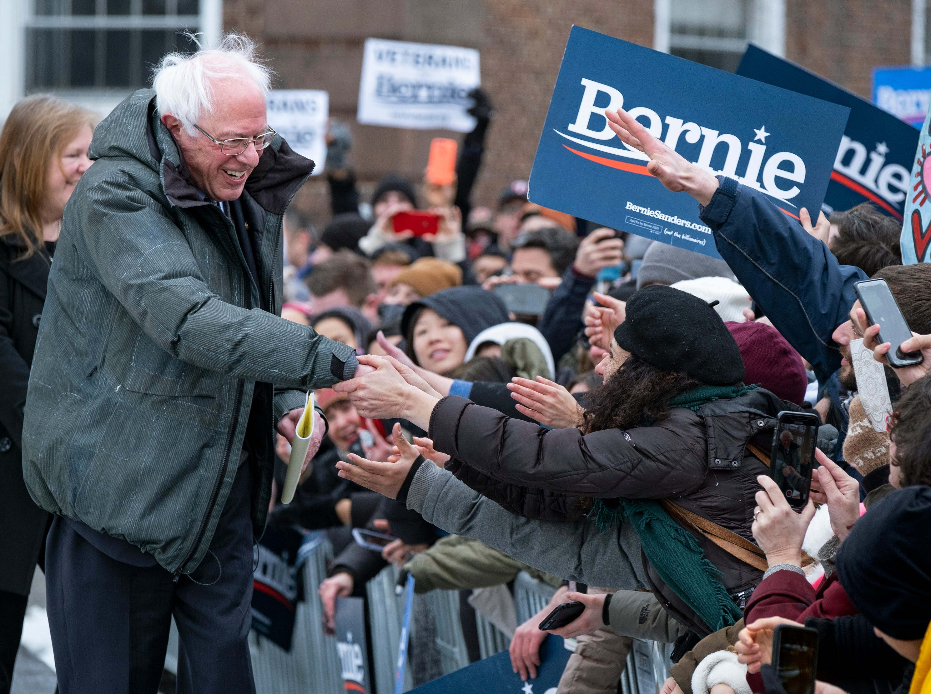 Sen. Bernie Sanders, I-Vt., is surrounded by supporters as arrives to kick off his second presidential campaign Saturday, March 2, 2019, in the Brooklyn borough of New York.