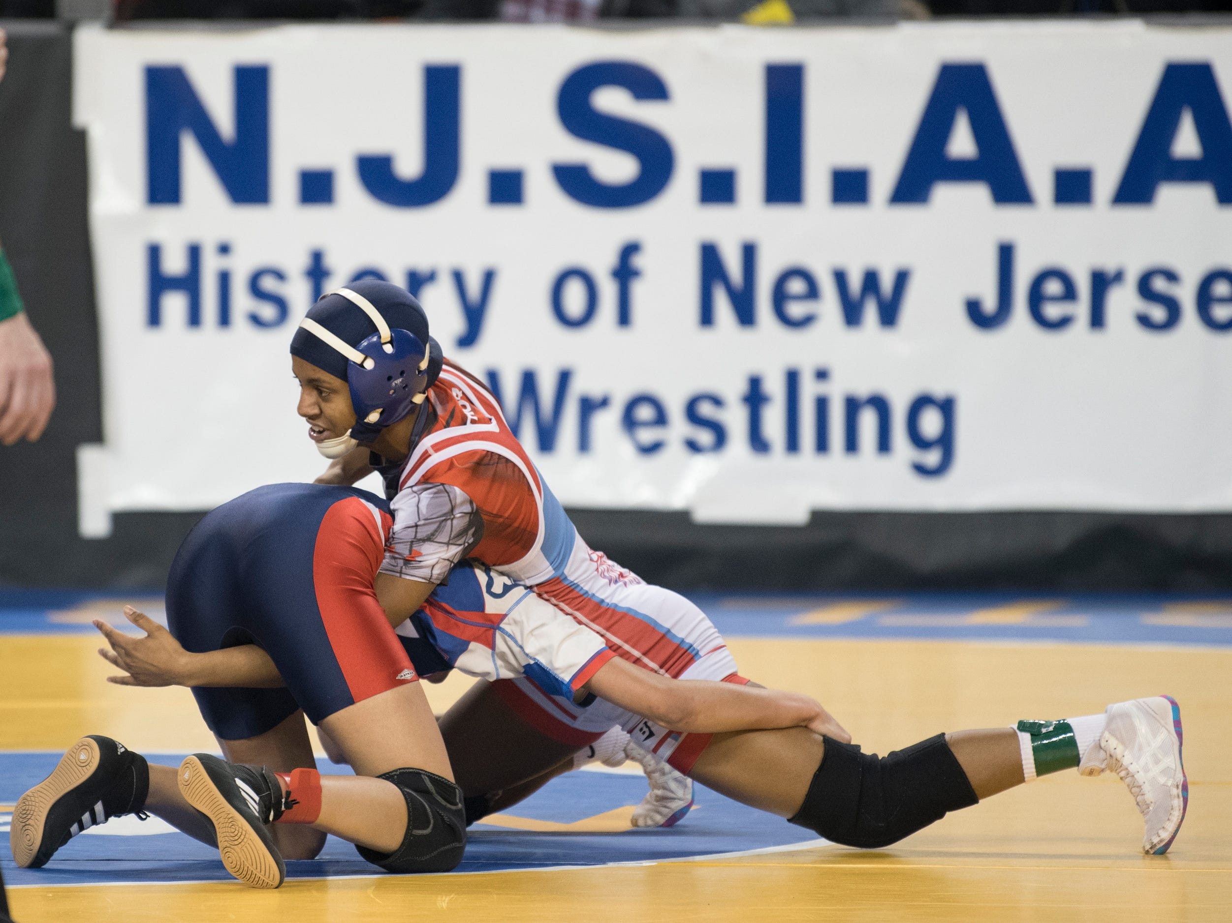 Pennsauken's Annmarie Lebron, top, controls Breanna Cervantes of Seacaucus during an 100 lb., opening round bout of the 2019 NJSIAA Girls State Wrestling Championships tournament held at Boardwalk Hall in Atlantic City on Friday, March 1, 2019.  Lebron won by pin.