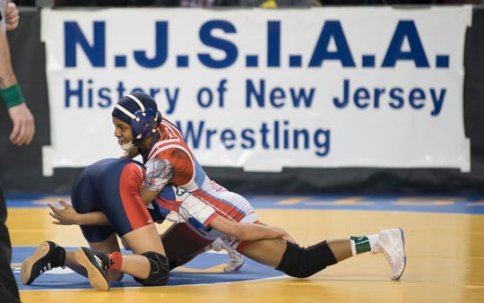 2019 Njsiaa State Wrestling Championships Day 2 2 Pennsauken's Anmarie Lebron, top, controls Breanna Cervantes of Seacaucus during an 100 lb., opening round bout of the 2019 NJSIAA Girls State Wrestling Championships tournament held at Boardwalk Hall in Atlantic City on Friday, March 1, 2019. Lebron won by pin.
