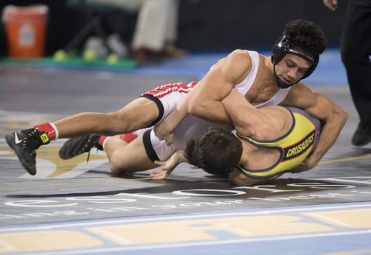 Paulsboro's  Jacob Perez-Eli turns Bergen Catholic's Alex Strashinsky onto his back during a 138 lb. semifinal round bout of the 2019 NJSIAA State Wrestling Championships tournament held at Boardwalk Hall in Atlantic City on Friday, March 1, 2019.   Perez-Eli won the bout, 5-2.