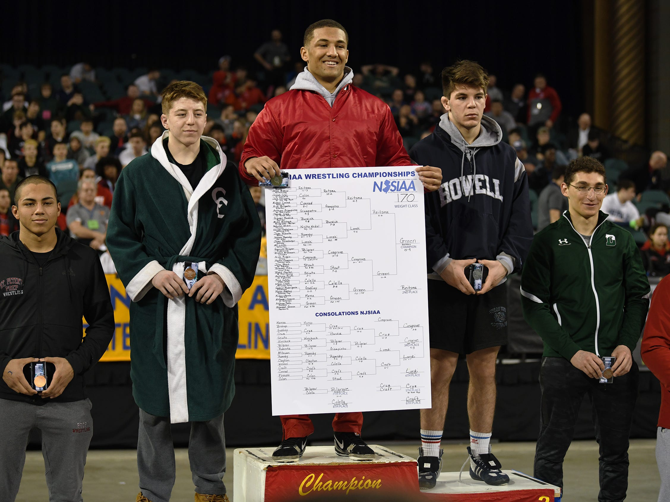 Paulsboro's Brandon Green, center, stands on top of the podium after his 13-9 win over Howell's Shane Reitsma during the 170 lb. championship bout of the 2019 NJSIAA State Wrestling Championships tournament held at Boardwalk Hall in Atlantic City on Saturday, March 2, 2019.