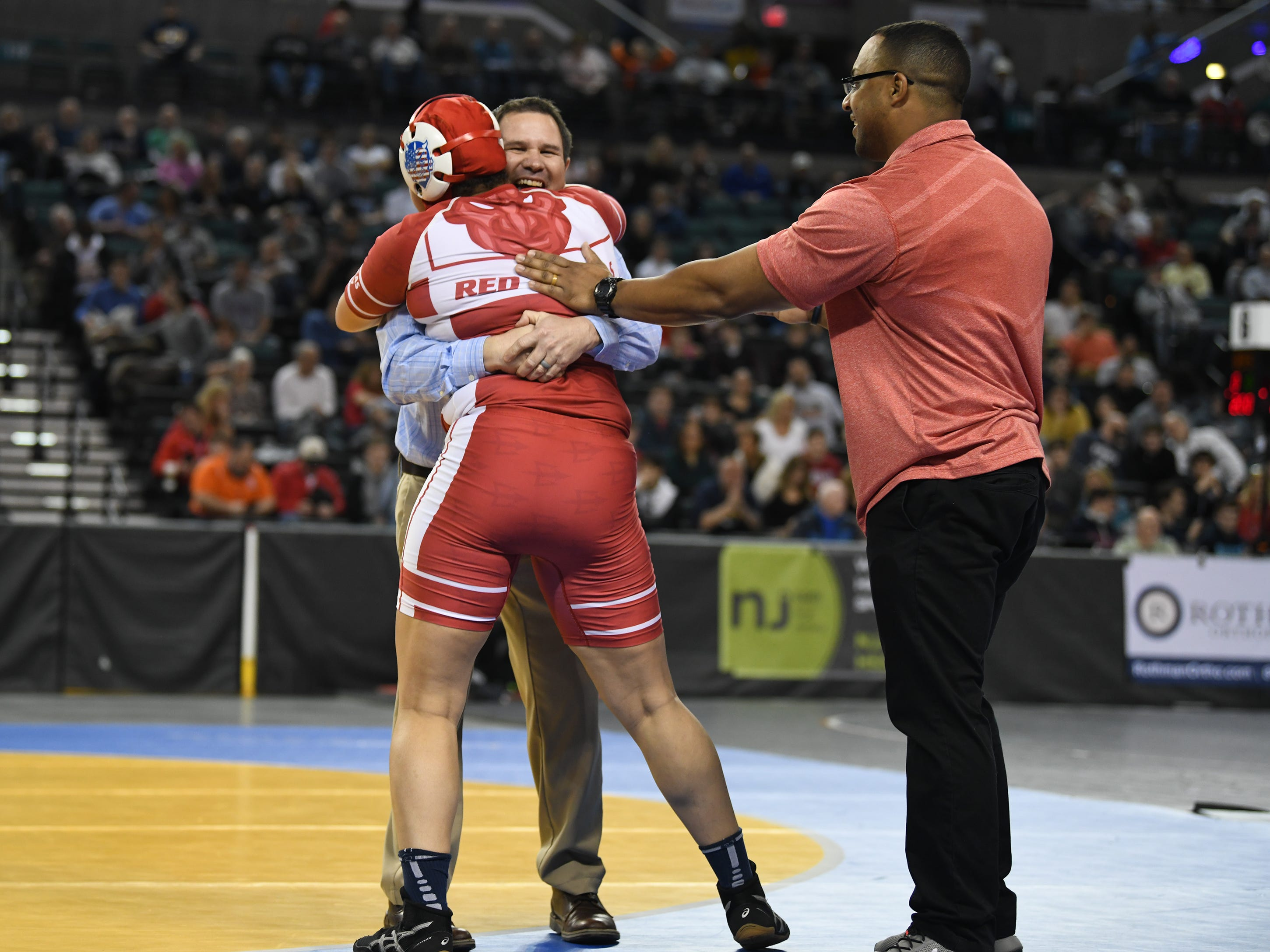 Rancocas Valley's Kaila Mungo celebrates with her coaches after defeating Kittatinny's Kiera Hubmaster, 2-1, in the 235 lb. championship bout of the 2019 NJSIAA Girls State Wrestling Championships tournament held at Boardwalk Hall in Atlantic City on Saturday, March 2, 2019.