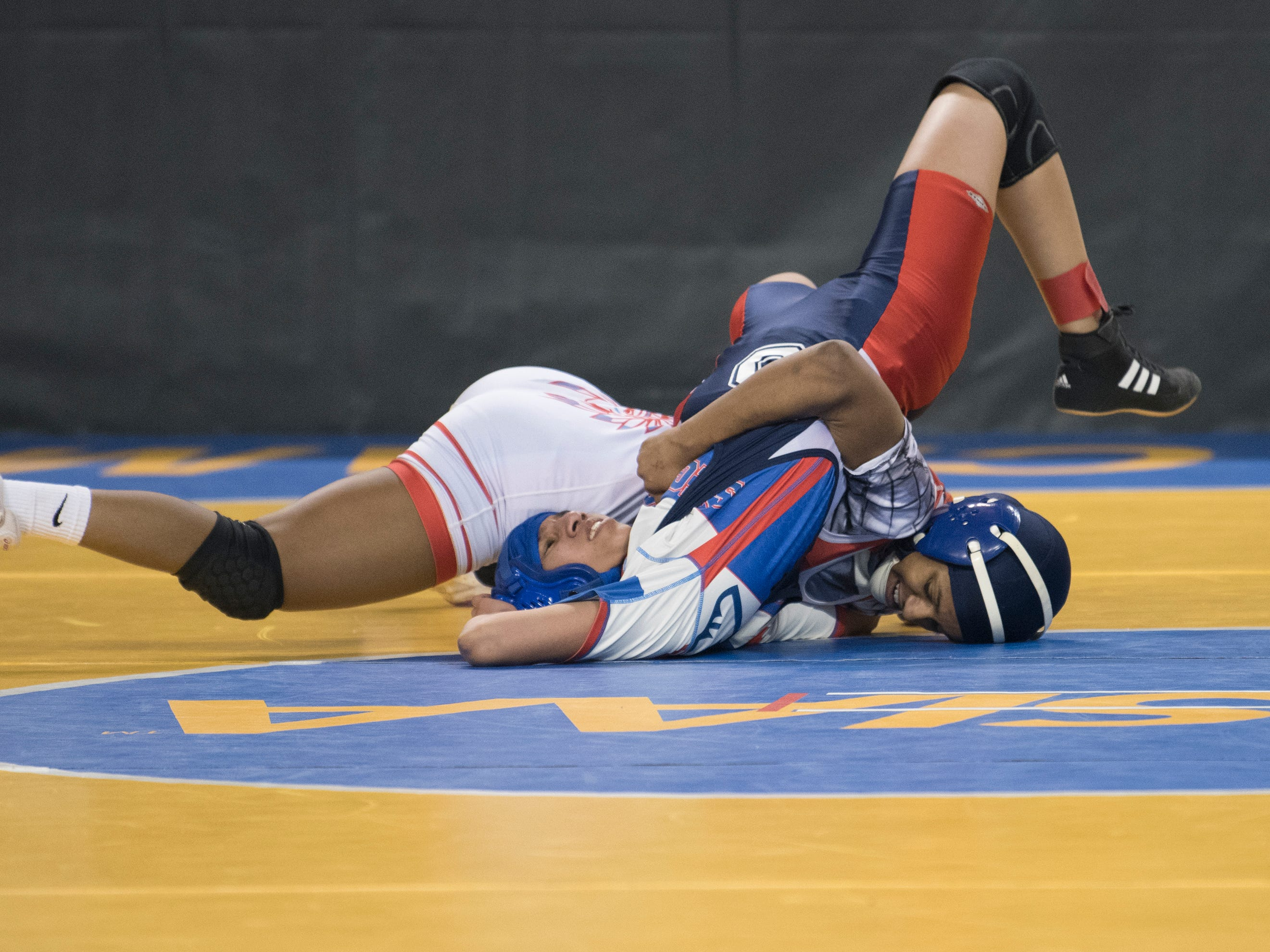 Pennsauken's Annmarie Lebron pins Breanna Cervantes of Seacaucus to win an 100 lb., opening round bout of the 2019 NJSIAA Girls State Wrestling Championships tournament held at Boardwalk Hall in Atlantic City on Friday, March 1, 2019.