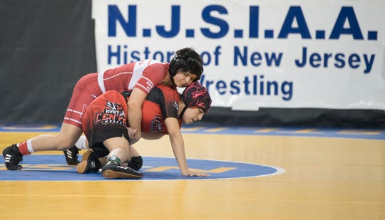 Rancocas Valley's Madison Trotman, top,,  controls Hunterdon Central's Melanie Sancho during an 127 lb., opening round bout of the 2019 NJSIAA Girls State Wrestling Championships tournament held at Boardwalk Hall in Atlantic City on Friday, March 1, 2019.  Trotman won the bout, 2-1.