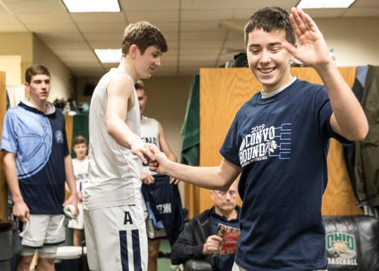 Brandon Smith hangs out in the locker room with the Adena Warriors' 2018-19 boys basketball team at Ohio University's Convocation Center during the Warriors' run to win a district championship.
