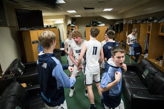 Senior Caleb Foglesong celebrates with his teammates after defeating the Ironton Fighting Tigers Saturday night in a Division III district semifinal game at Ohio University's Convocation Center in Athens, Ohio, on March 2, 2019.