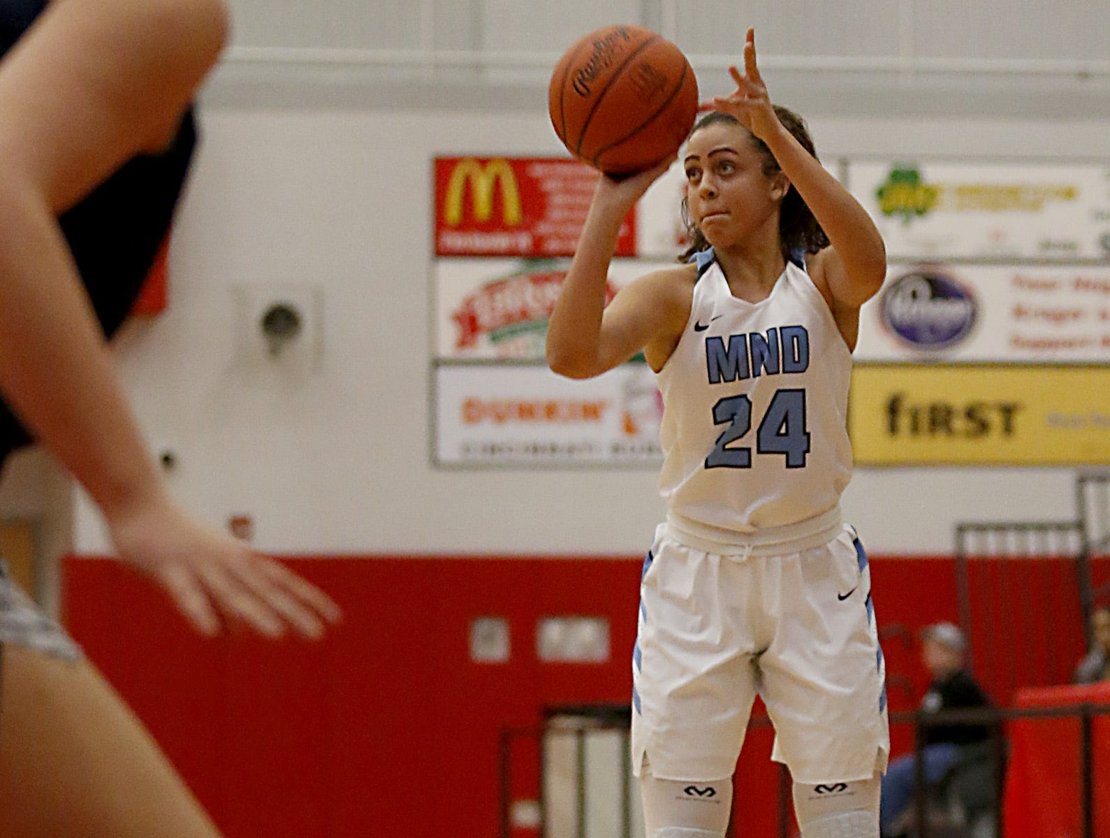 Mt. Notre Dame's Gabbie Marshall hits a three well behind the arc against Kettering Fairmont during the Southwest District Girls Division I finals at Princeton High School in Cincinnati Saturday, March 2, 2019.