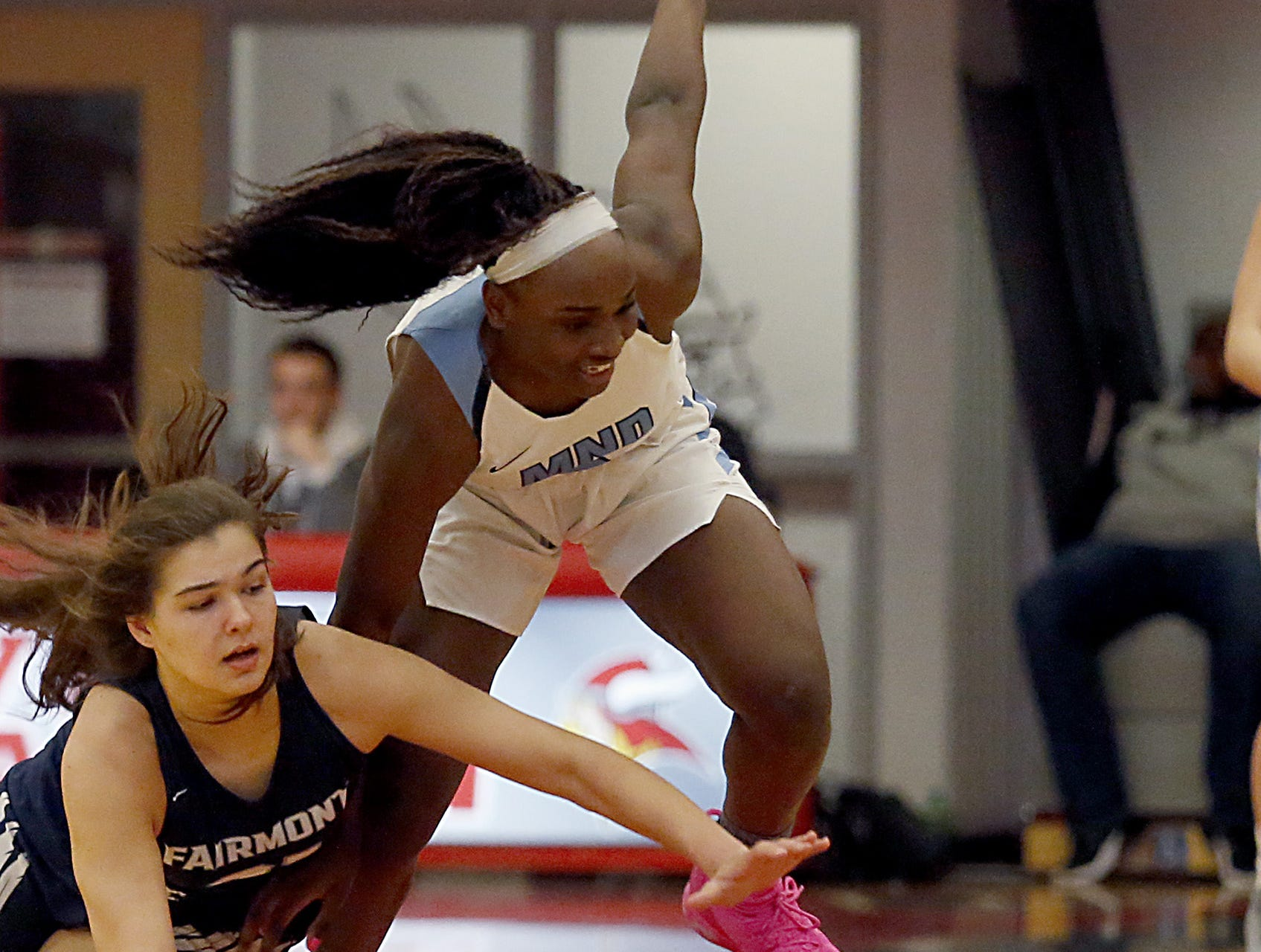 Fairmont guard Makira Copeland and Mt. Notre Dame's K.K. Bransford chase a loose ball during the Southwest District Girls Division I finals at Princeton High School in Cincinnati Saturday, March 2, 2019.