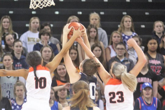 Notre Dame and Ryle battle for a rebound during the KHSAA 9th Region girls basketball semifinals March 2, 2019 at BB&T Arena, Highland Heights KY. Dixie Heights beat Highlands 42-39 and Ryle beat Notre Dame 51-34.