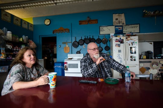 Darrell Whisman and his wife, Brenda, watch television in their kitchen, formerly a handicapped-accessible classroom, at Poasttown Elementary School on Tuesday, Feb. 5, 2019, in Madison Township. The couple transformed parts of the school into a residence and have been residing in it since 2004.