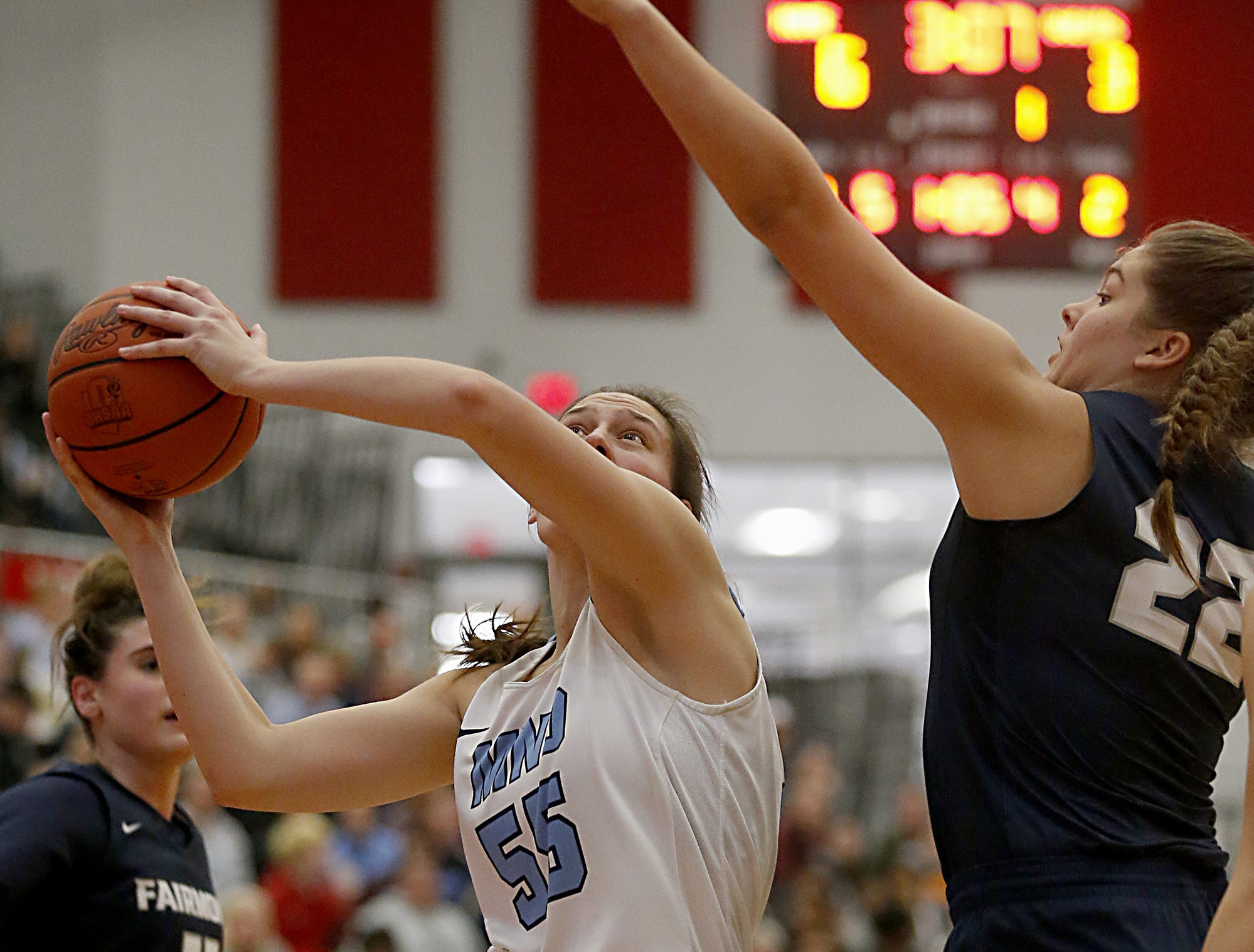Mt. Notre Dame's Julia Hoefling scores against Kettering Fairmont's Madison Bartley during the Southwest District Girls Division I finals at Princeton High School in Cincinnati Saturday, March 2, 2019.