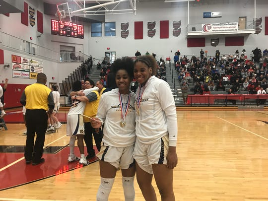 Junior Sean Kelly Darks (left) and senior Kennedi Myles (right) pose after leading Walnut Hills to a D-I district championship Saturday at Princeton High School. The duo combined for 37 points in the 58-49 victory over Wayne.