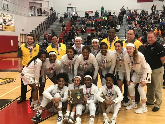 Walnut Hills claimed its second straight Division I district title after a 58-49 victory over Huber Heights Wayne Saturday afternoon at Princeton High School.