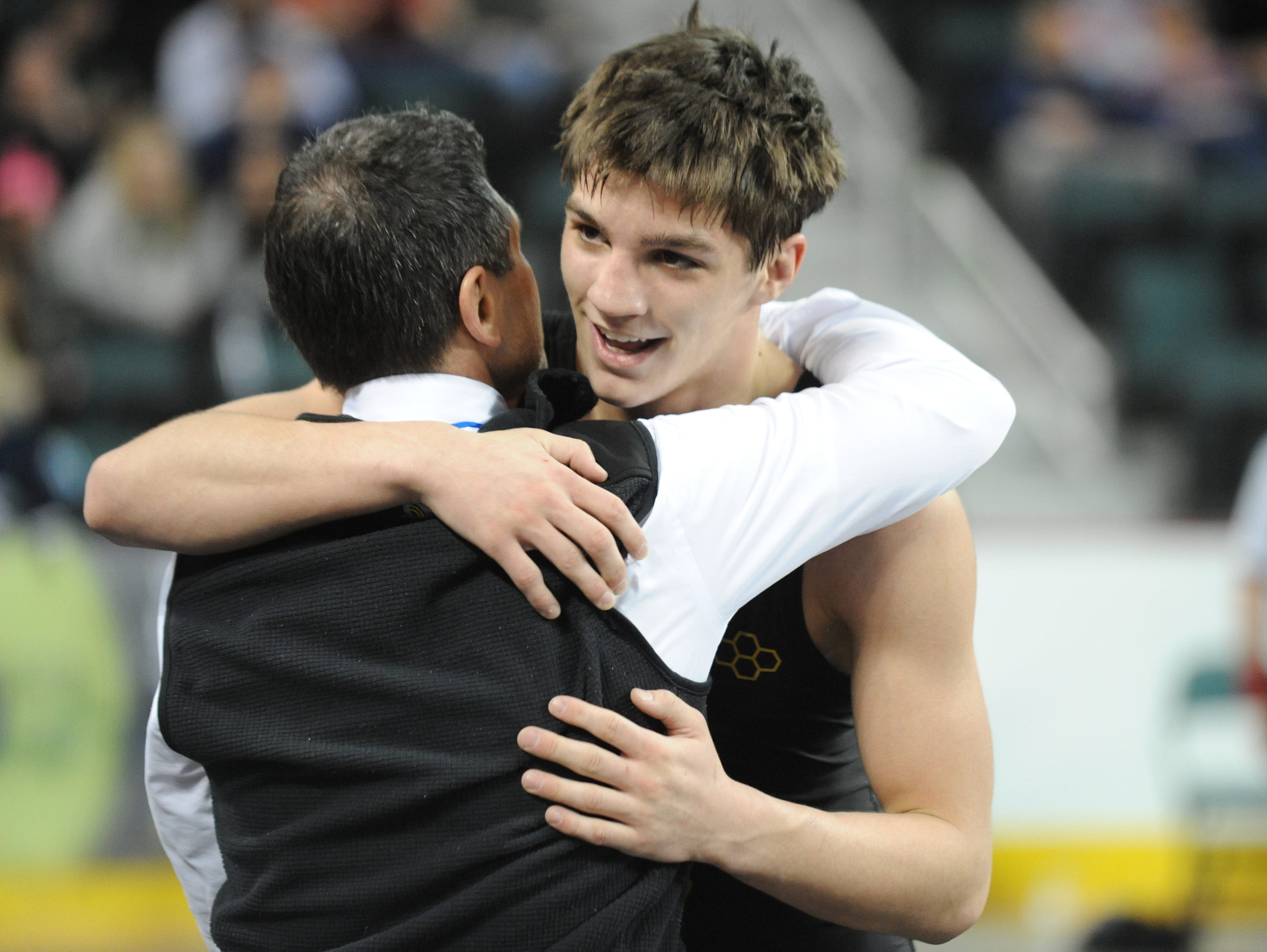 North Hunterdon's Michael Wilson hugs his coach after winning his 160-pound 7th place both against West Orange's Colin Morgan during the NJSIAA Individual Wrestling Championships at Boardwalk Hall in Atlantic City, Saturday, March 2, 2019.