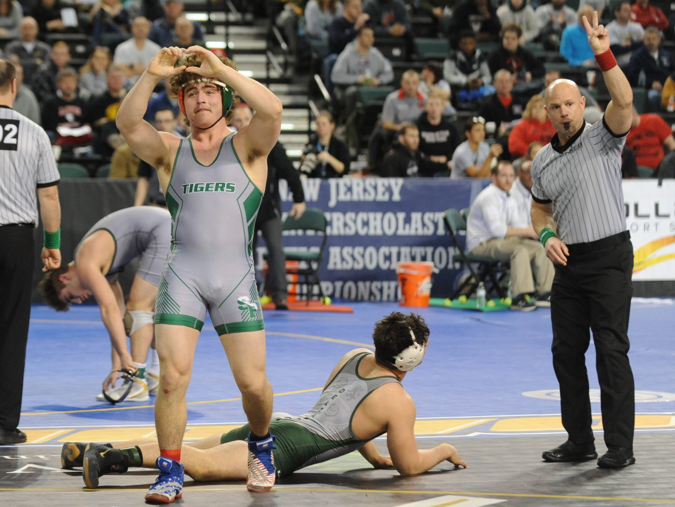 South Plainfield's Luke Niemeyer reacts after defeating Delbarton's Luke Chakonis in a 195-pound quarterfinal bout during the NJSIAA Individual Wrestling Championships at Boardwalk Hall in Atlantic City, Friday, March 1, 2019.