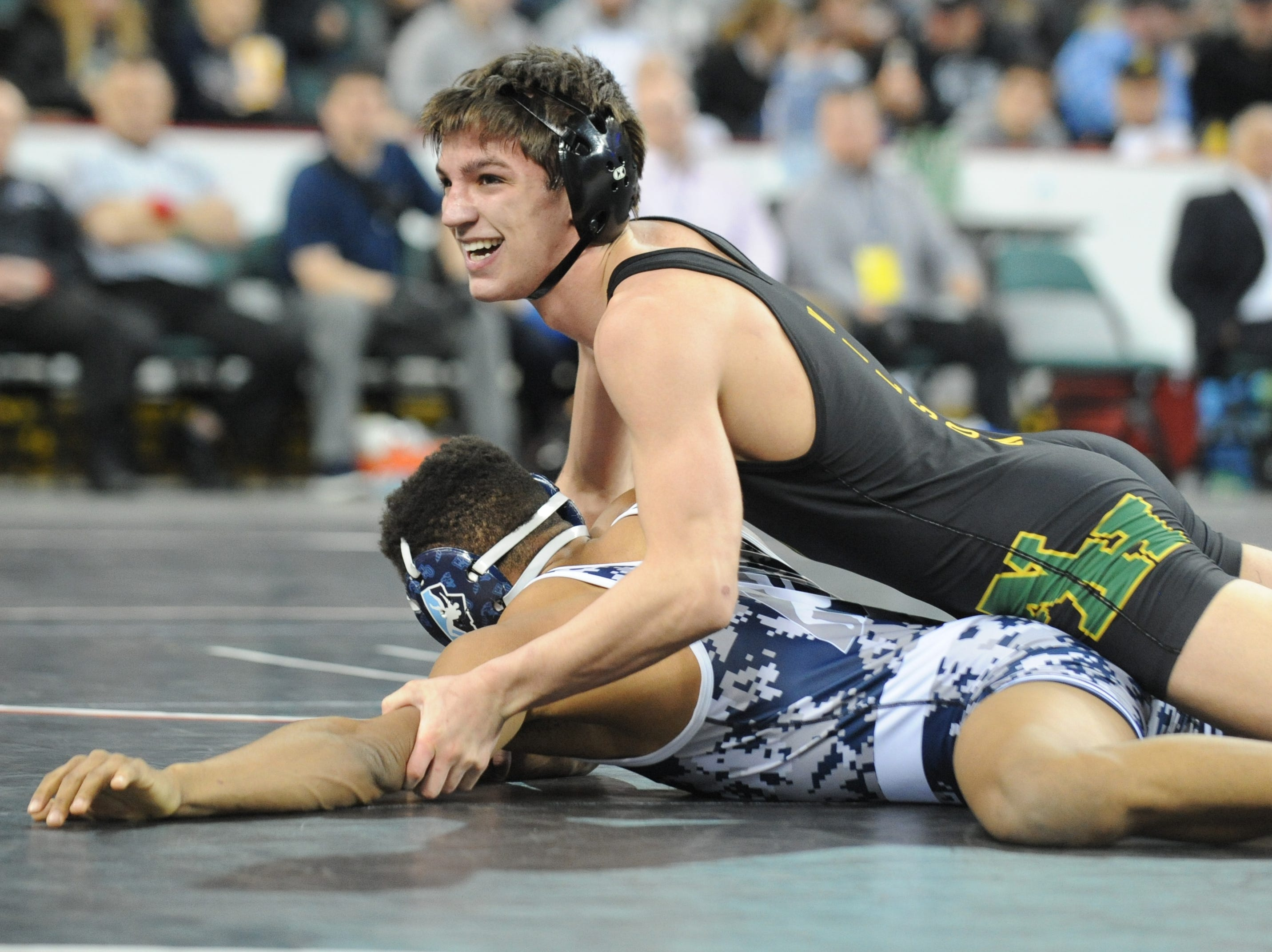 North Hunterdon's Michael Wilson smiles as he defeats West Orange's Colin Morgan in a 160-pound 7th place bout during the NJSIAA Individual Wrestling Championships at Boardwalk Hall in Atlantic City, Saturday, March 2, 2019.