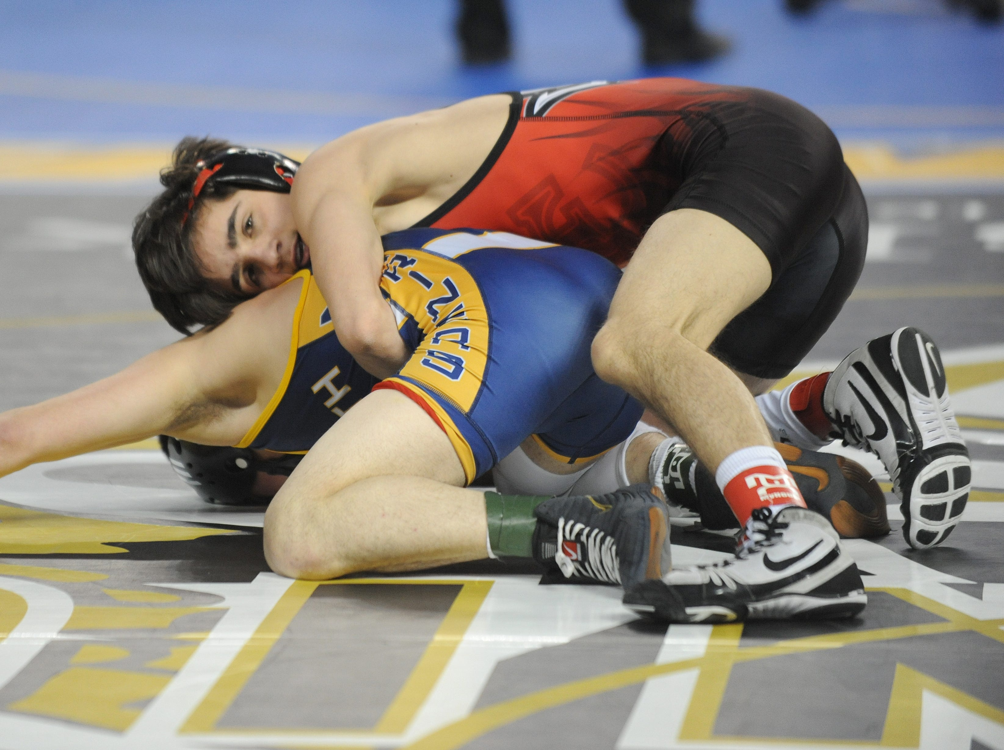 Hunterdon Central's Brett Ungar wrestles Toms River North's Louie Gagliardo in a 106-pound quarterfinal bout during the NJSIAA Individual Wrestling Championships at Boardwalk Hall in Atlantic City, Friday, March 1, 2019.