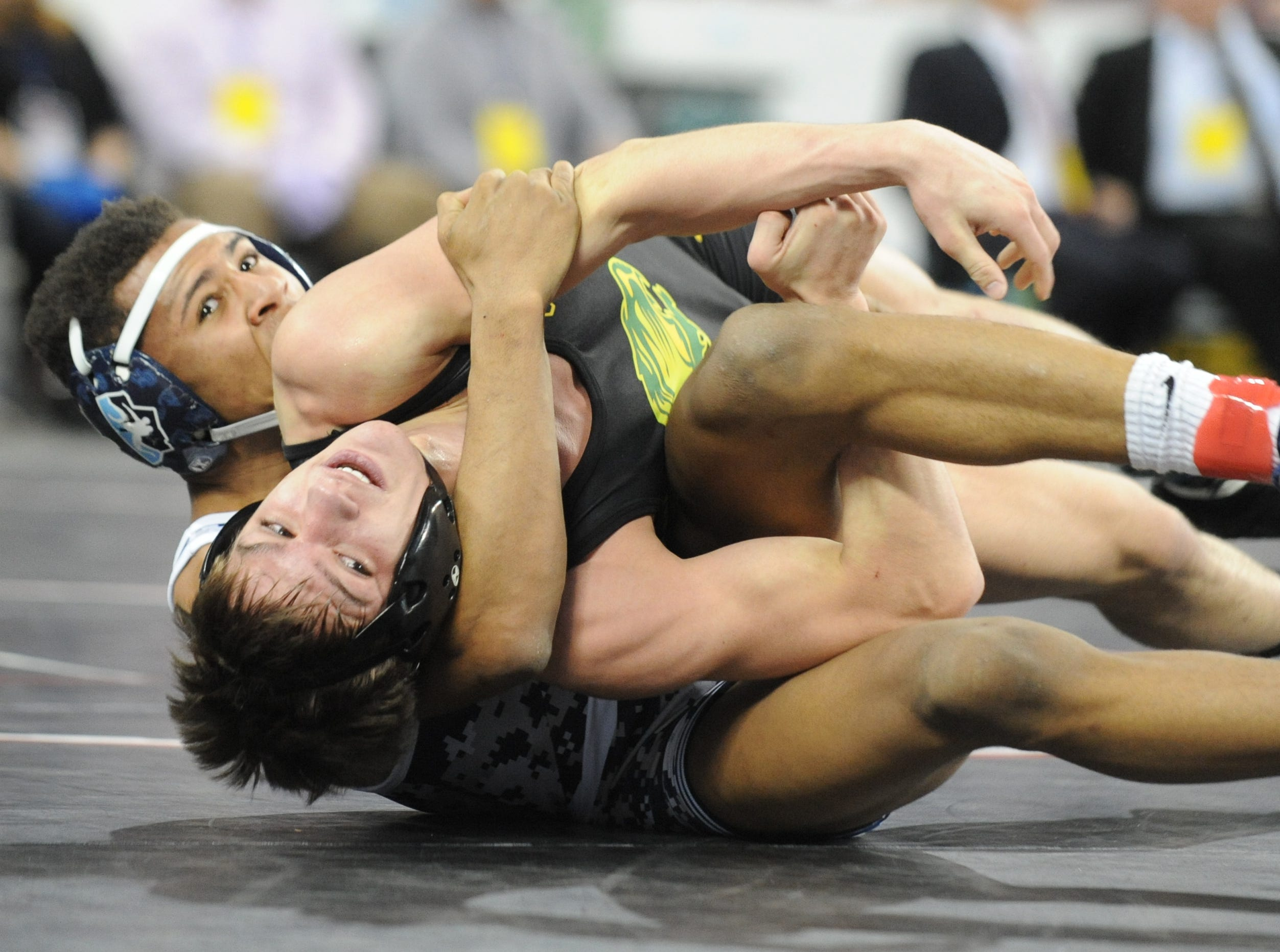 North Hunterdon's Michael Wilson wrestles West Orange's Colin Morgan in a 160-pound7th place bout during the NJSIAA Individual Wrestling Championships at Boardwalk Hall in Atlantic City, Saturday, March 2, 2019.
