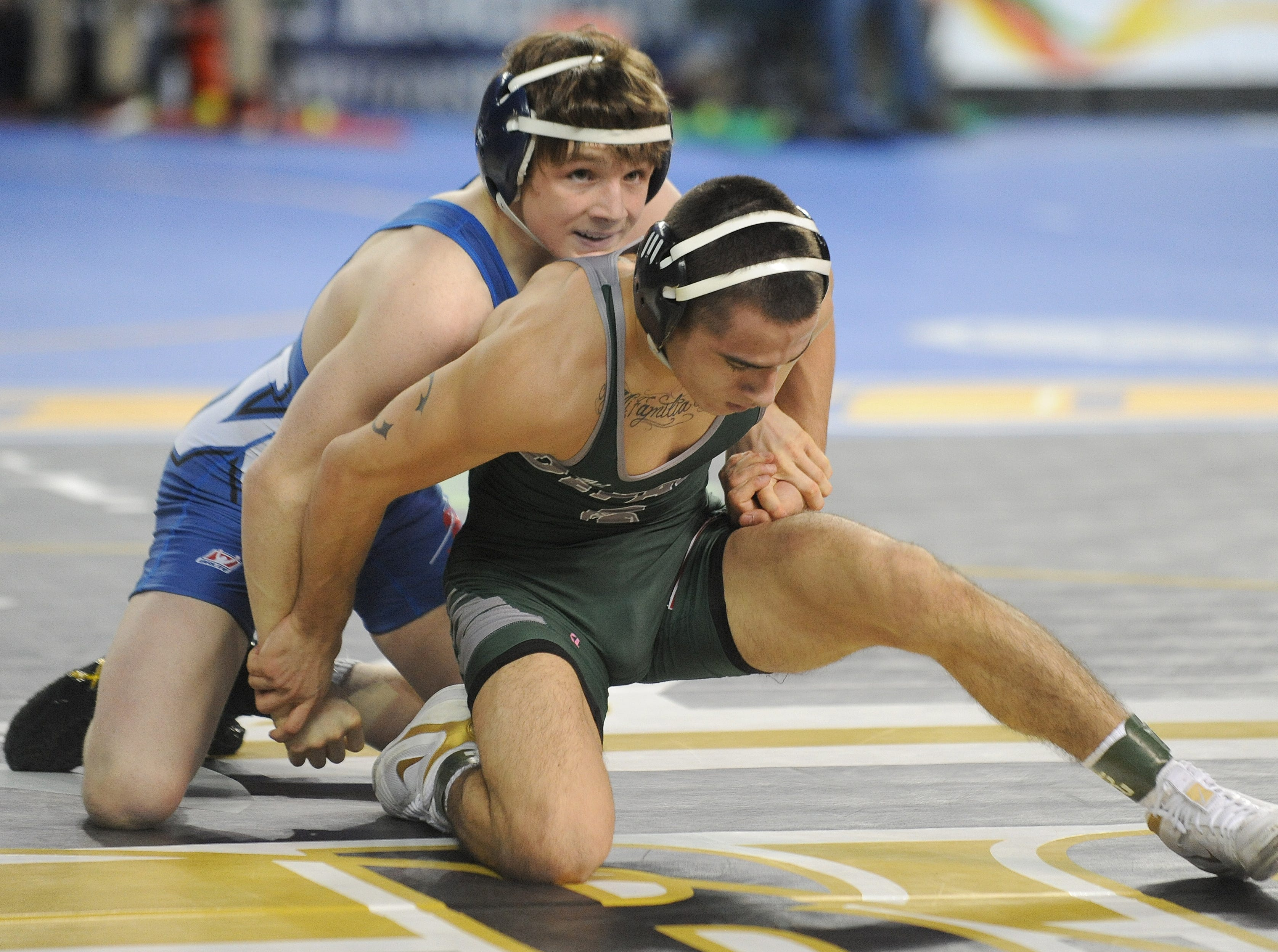 Westfield's CJ Composto wrestles DuPaul's Nicky Cabanillas in a 126-pound quarterfinal bout during the NJSIAA Individual Wrestling Championships at Boardwalk Hall in Atlantic City, Friday, March 1, 2019.