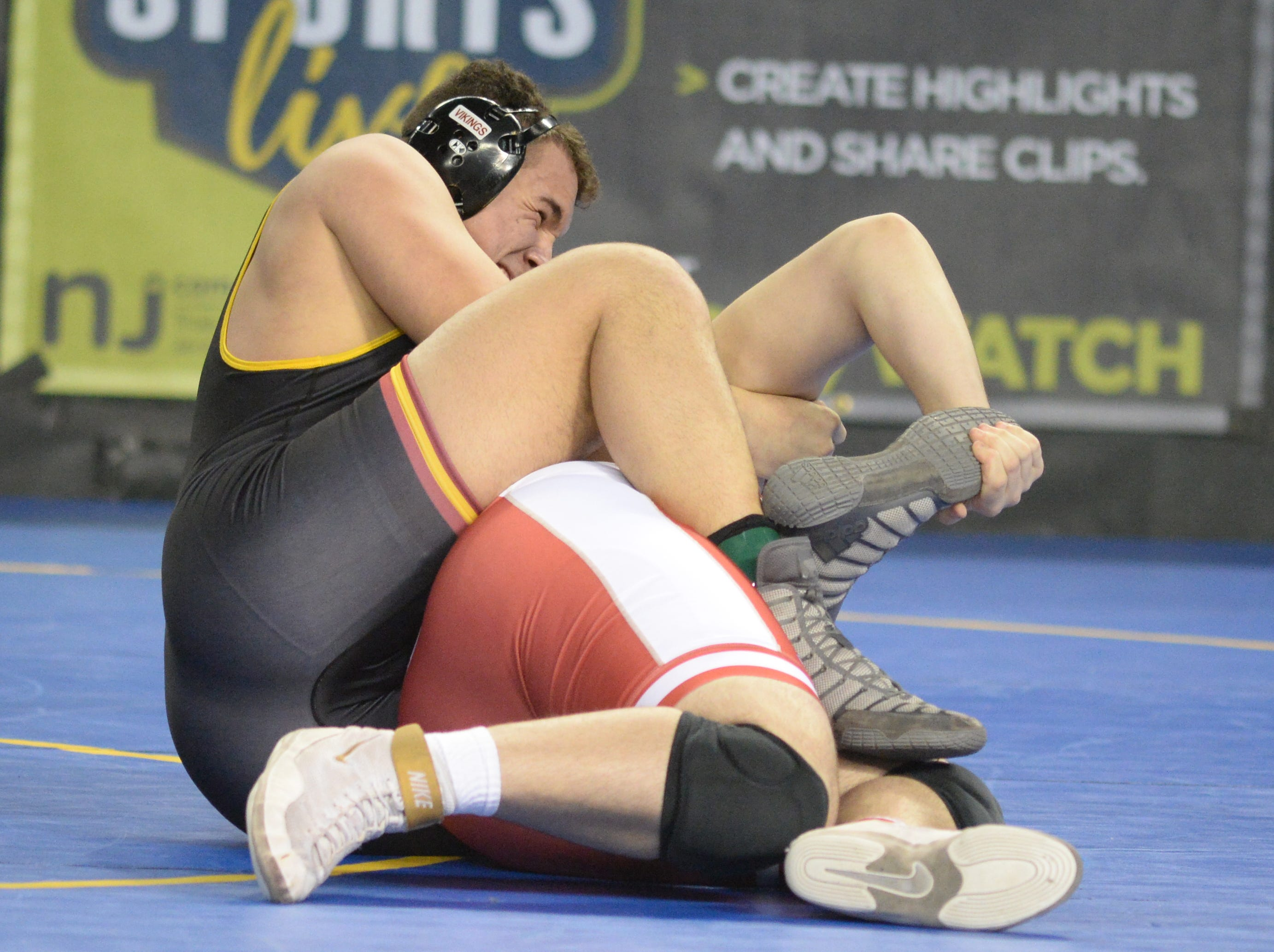 Voorhees' Lewis Fernandes wrestles Ocean Township's Joseph Teresi in a 285-pound quarterfinal bout during the NJSIAA Individual Wrestling Championships at Boardwalk Hall in Atlantic City, Friday, March 1, 2019.