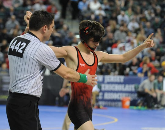 Hunterdon Central's Brett Ungar reacts after defeating Toms River North's Louie Gagliardo in a 106-pound quarterfinal bout during the NJSIAA Individual Wrestling Championships at Boardwalk Hall in Atlantic City, Friday, March 1, 2019.