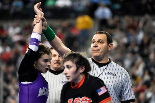 Monroe's Gabby Miller has her hand raised in victory at the inaugural NJSIAA girls wrestling tournament in Atlantic City