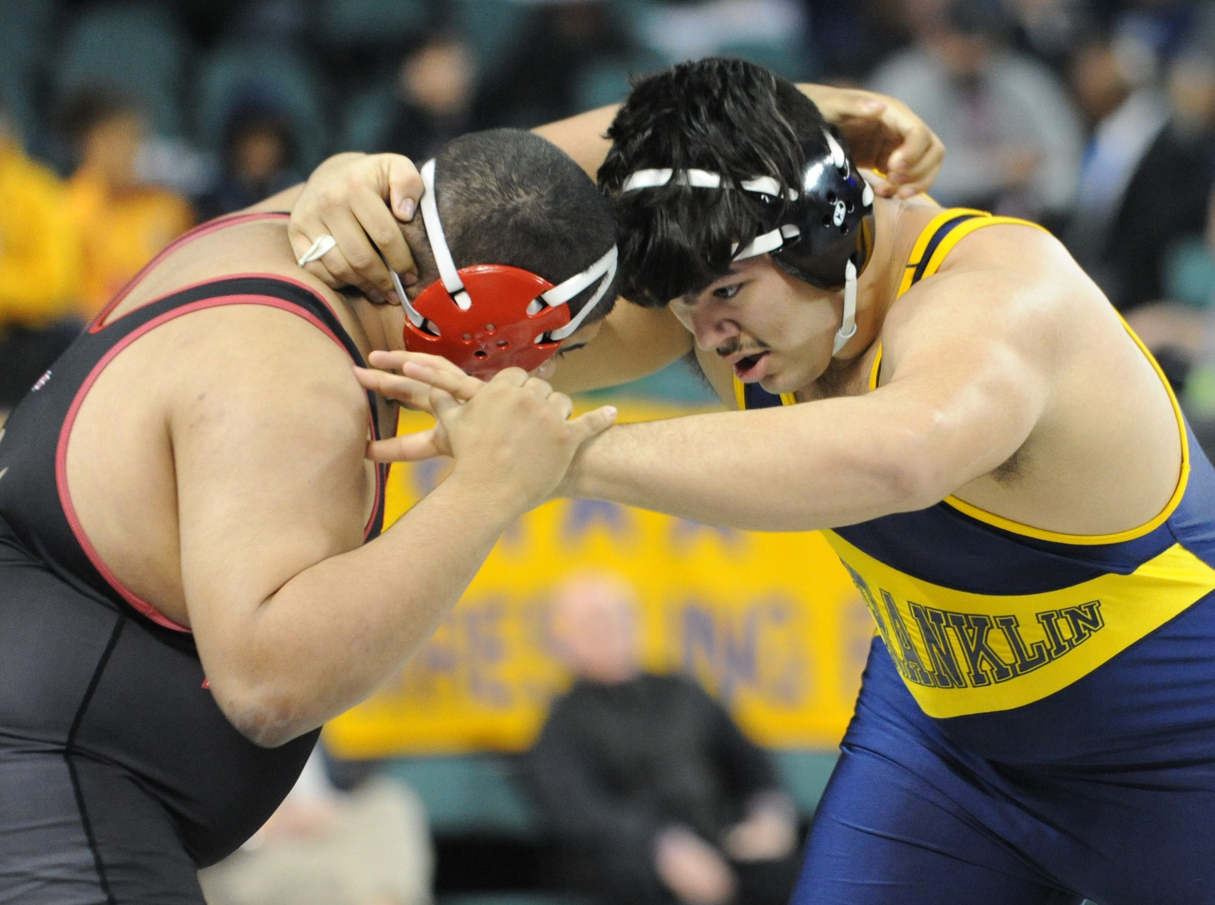 Franklin's Marcus Estevez wrestles Mt. Olive's Jayvon Davidson in a 285-pound 5th place bout during the NJSIAA Individual Wrestling Championships at Boardwalk Hall in Atlantic City, Saturday, March 2, 2019.