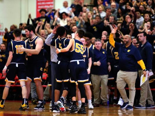 The Colonia boys basketball team celebrates its win over Rahway in the NJSIAA North 2 Group III semifinals on Saturday, March 2, 2019 at Rahway High School.