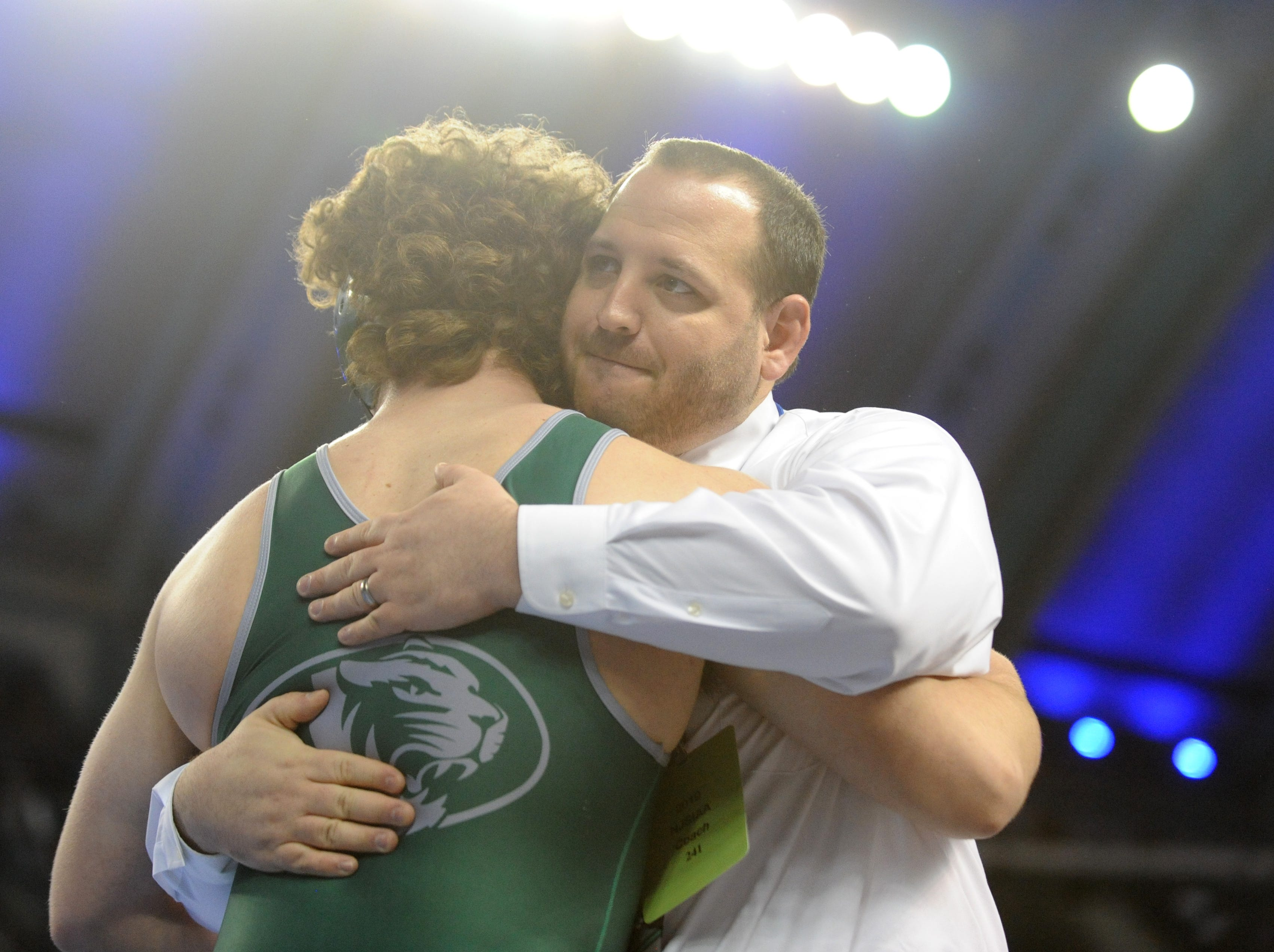 South Plainfield's Luke Niemeyer hugs his coach after defeating Delbarton's Luke Chakonis in a 195-pound 3rd place bout during the NJSIAA Individual Wrestling Championships at Boardwalk Hall in Atlantic City, Saturday, March 2, 2019.