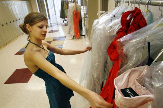 Ankeny High School senior Whitney Peters of Ankeny looks through a rack of prom dresses at the Project Fresh Start dress giveaway in 2009.