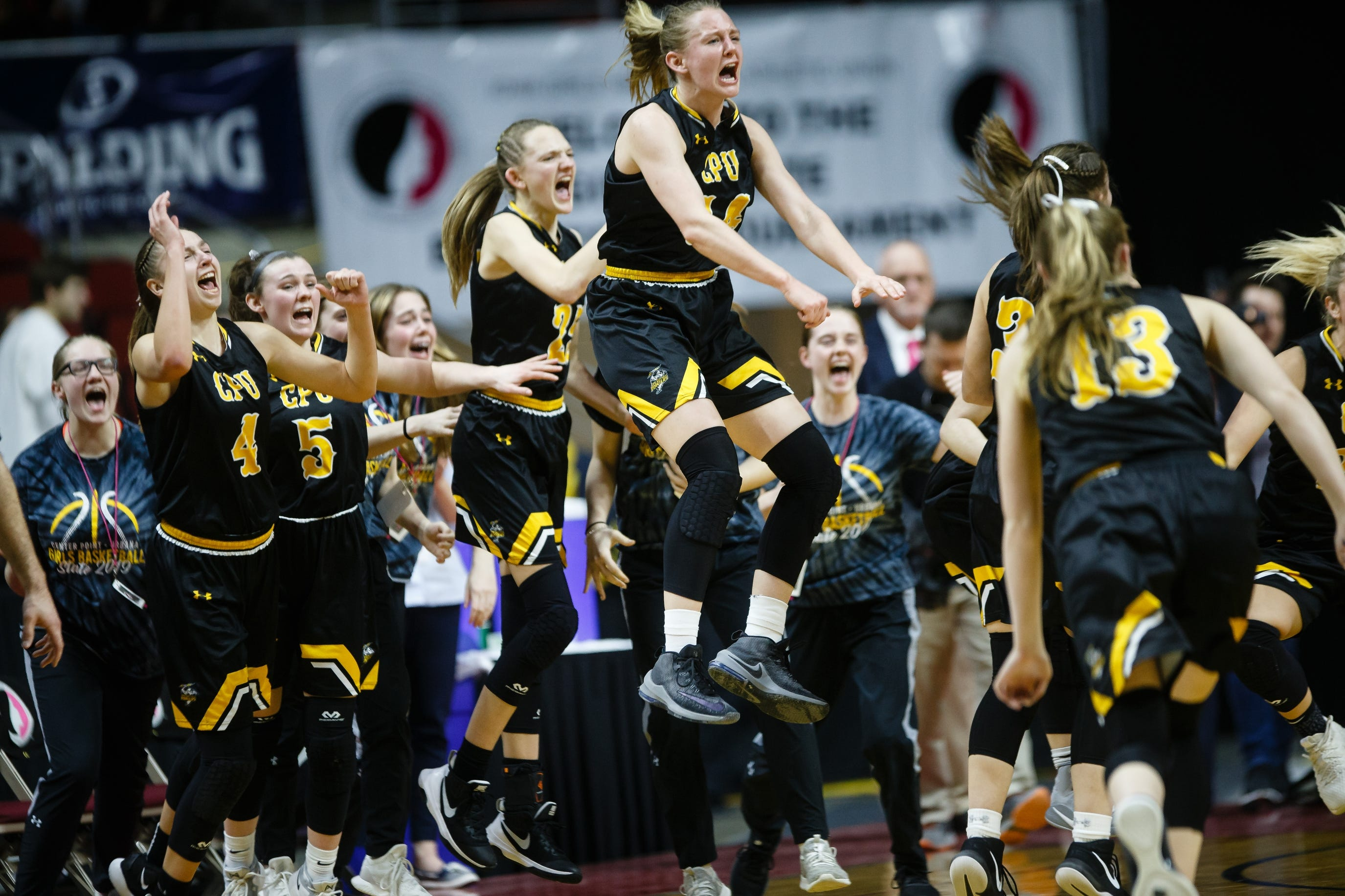 Center Point-Urbana celebrates as the final seconds wind down and they defeat North Polk during their 3A girls' state basketball championship game on Friday, March 1, 2019 in Des Moines.